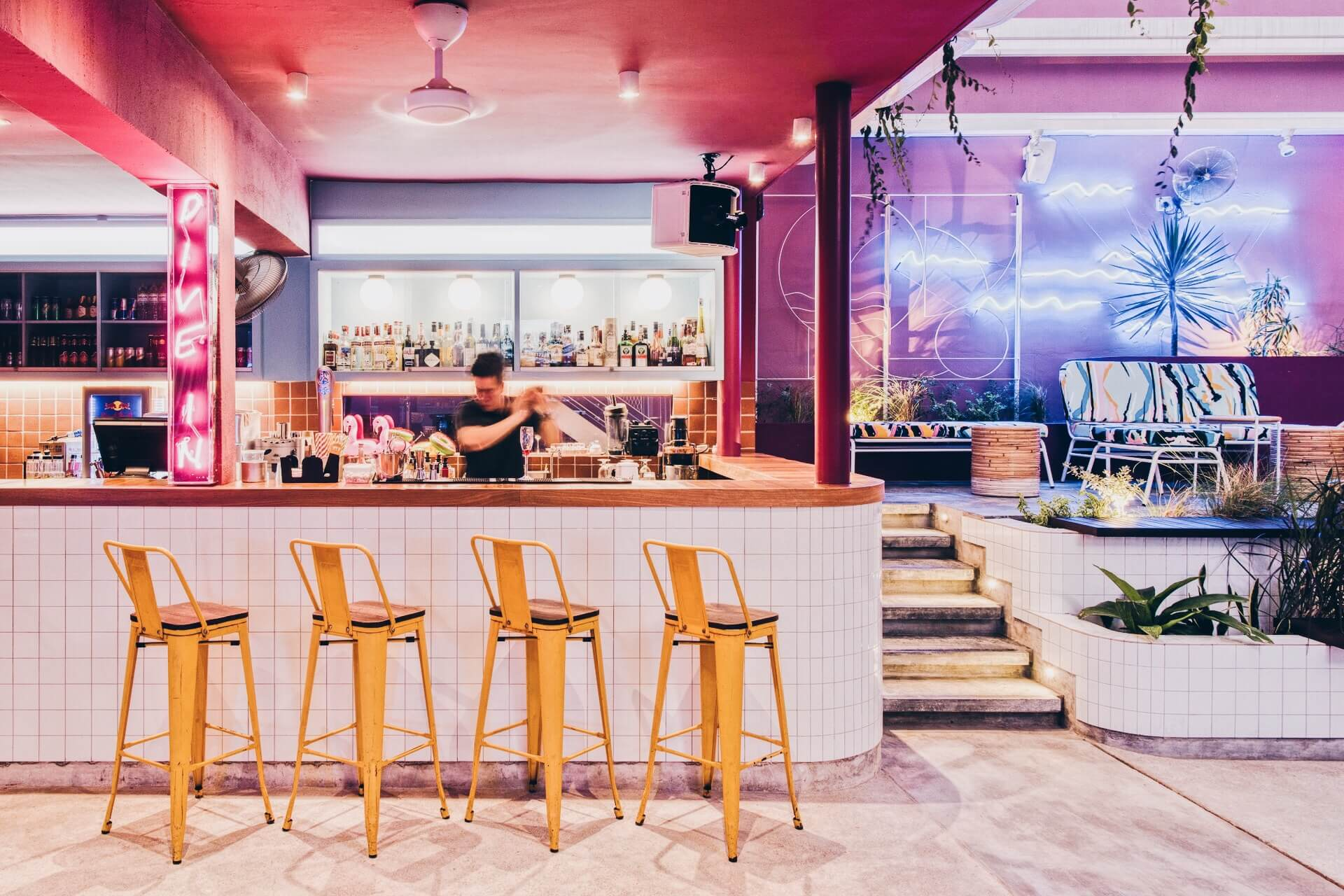 Rooftop bar with neon signs at KL Journal Hotel