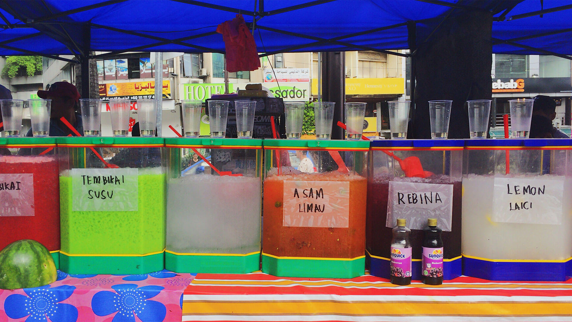 Street fruit juice bar with a variety of beverage options