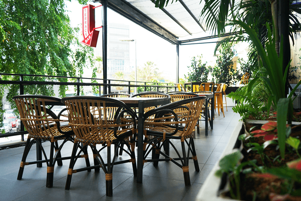 Terrace event space with cane furniture at KL Journal Hotel
