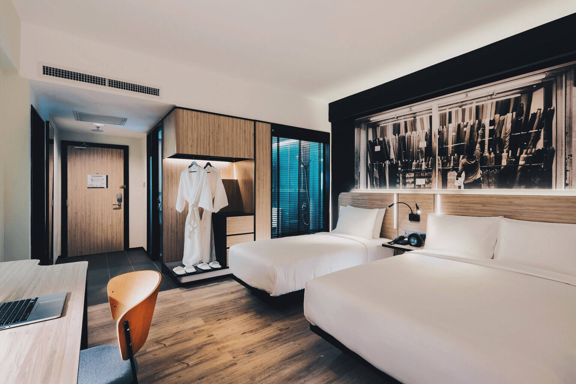 Chic and modern Deluxe Triple room at KL Journal Hotel
