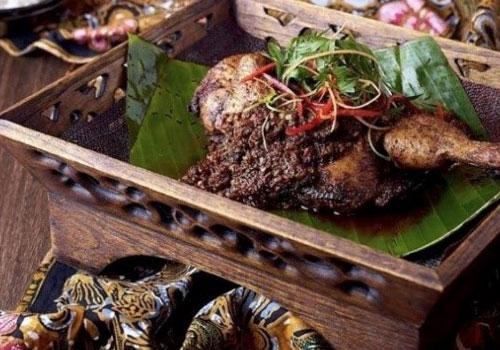 Chicken dish on a wooden platter